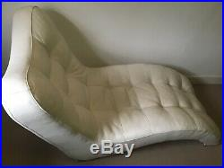 Stylish & comfortable white leather chaise longue, ideal for relaxing